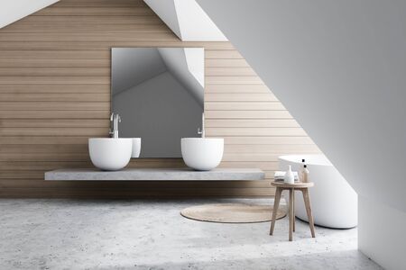 Interior of stylish bathroom with white and wooden walls, concrete floor, comfortable white bathtub and double sink standing on stone shelf with large mirror. 3d rendering