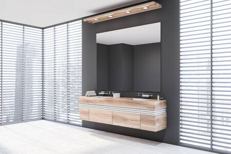 Corner of stylish bathroom with gray walls, tiled floor, double sink standing on wooden countertop with large mirror above it and windows with blinds. 3d rendering