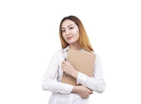 Isolated portrait of serious young Asian woman with long hair wearing white blouse and holding clipboard and pen. Concept of education and business