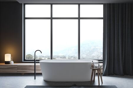Interior of stylish bathroom with dark gray walls, concrete floor and comfortable white bathtub standing under window with mountain view. 3d rendering Stock fotó