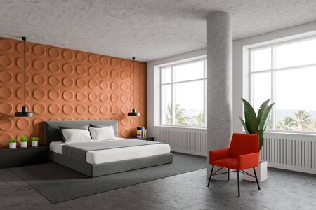 Corner of stylish bedroom with orange geometric pattern and white walls, concrete floor, king size bed with gray bedside tables and bright orange armchair near column. 3d rendering
