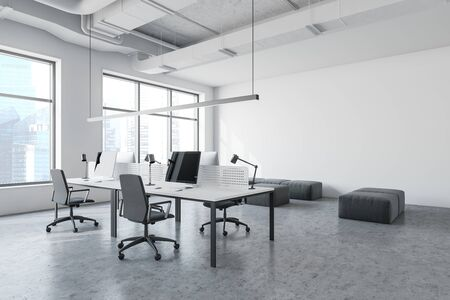Interior of modern open space office in industrial style with white walls, concrete floor, long computer tables with chairs and lounge area with gray poufs. 3d rendering
