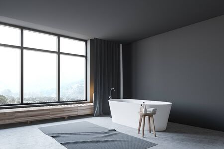 Corner of stylish bathroom with dark gray walls, concrete floor and comfortable white bathtub standing under window with mountain view. 3d rendering