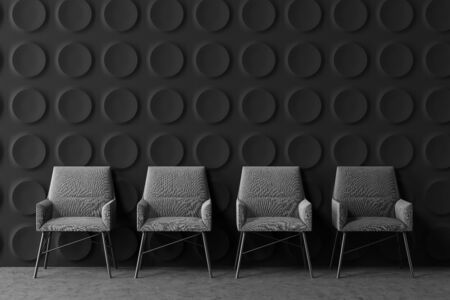 Row of comfortable gray armchairs in modern office lounge area with dark gray geometric pattern walls and concrete floor. 3d rendering