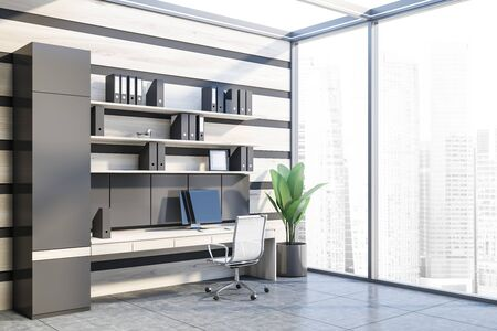 Corner of office workplace with gray and wooden walls, concrete floor, wooden computer table with shelves with folders above it and white metal chair. 3d rendering