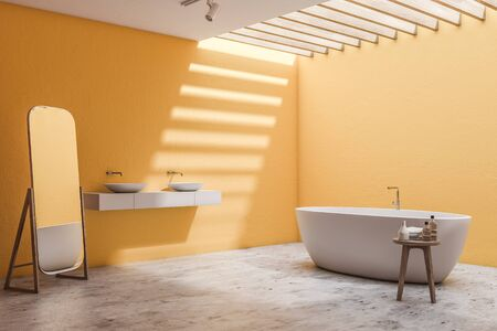 Corner of spacious bathroom with yellow walls, concrete floor, comfortable white bathtub, double sink on white countertop and mirror on the floor. 3d rendering