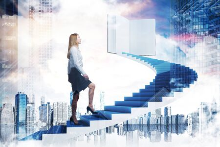 Young woman in suit climbing staircase in sky leading to large book. Cityscape below her. Concept of knowledge and education. Toned image double exposure