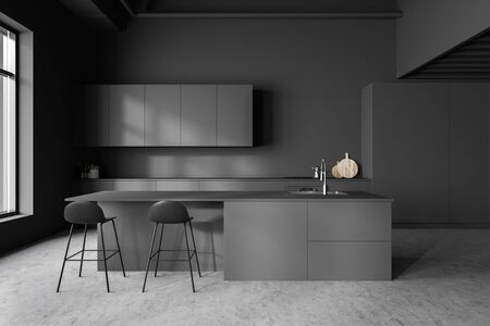 Interior of stylish kitchen with gray walls, concrete floor, grey countertops and cupboards and bar with stools. 3d rendering