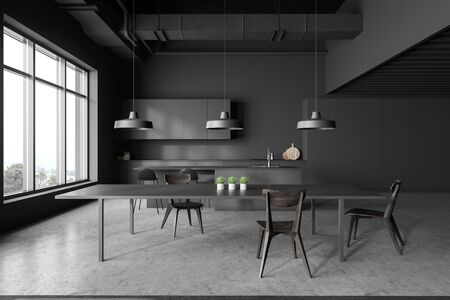 Interior of modern kitchen with gray walls, concrete floor, grey countertops and cupboards, bar with stools and dark gray dining table with chairs. 3d rendering 写真素材