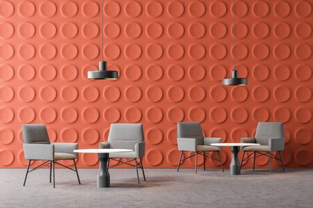 Interior of modern office lounge area with orange geometric pattern walls, concrete floor, comfortable gray armchairs near round coffee tables and stylish lamps. 3d rendering