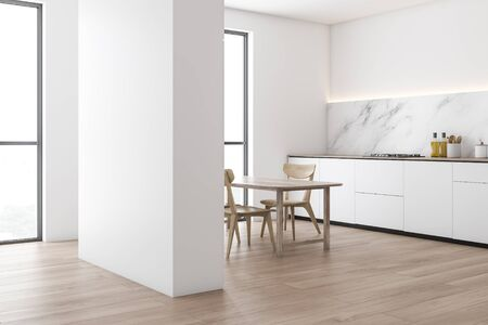 Corner of modern kitchen with white and marble walls, wooden floor, white countertops with built in cooker and wooden dining table with chairs. 3d rendering