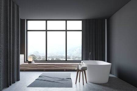 Side view of stylish bathroom with dark gray walls, concrete floor and comfortable white bathtub standing under window with mountain view. 3d rendering