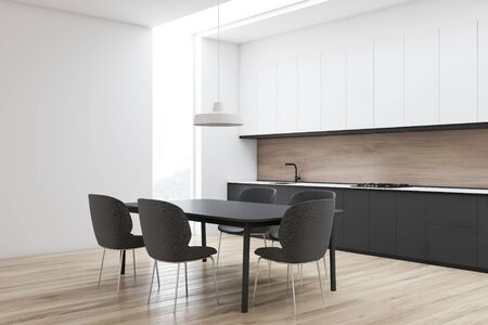 Corner of stylish kitchen with white and wooden walls, wooden floor, gray countertops, white cupboards and gray dining table with chairs. 3d rendering