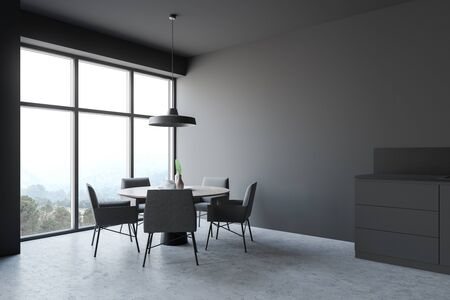 Corner of modern dining room and kitchen with gray walls, concrete floor, round table with grey chairs and dark gray countertop with built in sink. 3d rendering