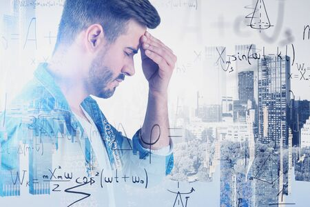 Side view of bearded man in casual clothes thinking hard in city with double exposure of formulas. Concept of education and science. Toned image Zdjęcie Seryjne - 129260103
