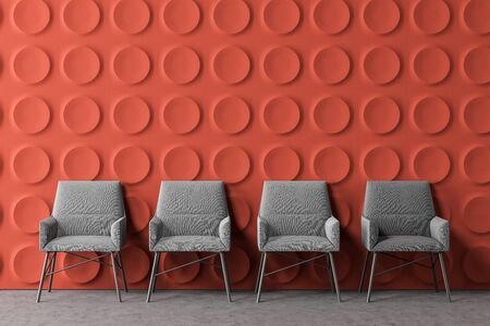 Row of comfortable gray armchairs in modern office lounge area with orange geometric pattern walls and concrete floor. 3d rendering