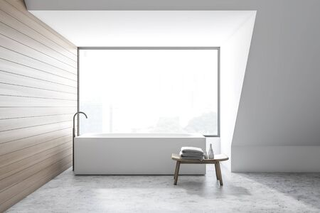 Interior of modern bathroom with white and wooden walls, concrete floor and angular bathtub standing near the window. 3d rendering