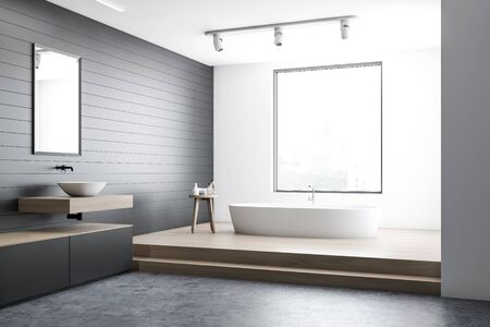 Corner of modern bathroom with white and gray walls, wooden and concrete floor, white sink standing on wooden shelf with mirror above it and comfortable bathtub. 3d rendering