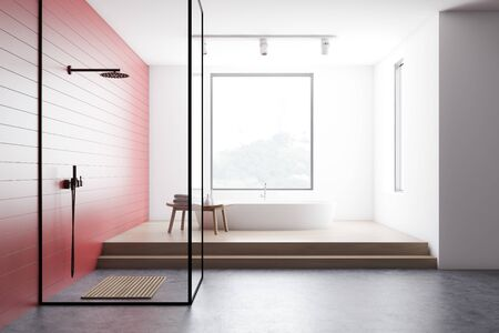 Interior of modern bathroom with red and white walls, concrete and wooden floor, comfortable white bathtub and walk in shower with glass walls. 3d rendering Stok Fotoğraf