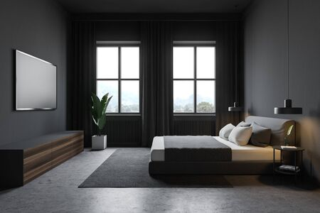 Side view of modern bedroom with grey walls, concrete floor with carpet, windows with curtains, comfortable king size bed and TV set on the wall. 3d rendering Reklamní fotografie
