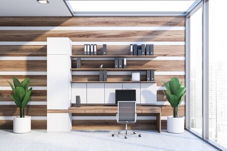Interior of office workplace with white and wooden walls, concrete floor, wooden computer table with shelves with folders above it and metal chair. 3d rendering Reklamní fotografie