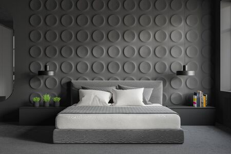Interior of stylish bedroom with gray geometric pattern walls, concrete floor with carpet, king size bed and two gray bedside tables. 3d rendering 写真素材