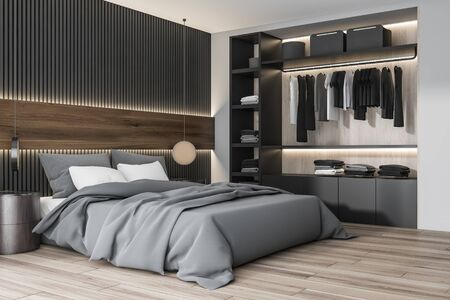 Corner of modern bedroom with white and gray wooden walls, wooden floor, king size bed with two round bedside tables and wardrobe with clothes. 3d rendering