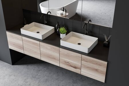 Top view of double bathroom sink standing on wooden countertop in modern room with gray tile walls and large mirrors. 3d rendering
