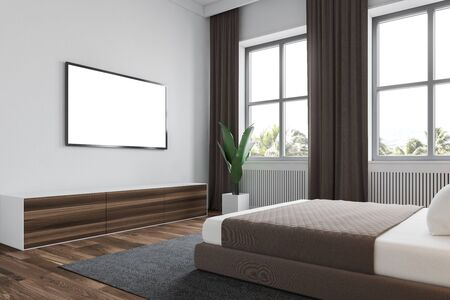 Interior of modern bedroom with white walls, wooden floor with carpet, windows with curtains, king size bed and TV with mock up screen. 3d rendering