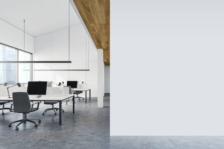 Interior of open space office with white walls, concrete floor, rows of white computer desks with gray chairs and mock up wall to the right. 3d rendering Reklamní fotografie