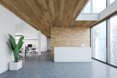 White reception table with laptop on it standing in modern open space office with white and wooden walls and concrete floor. 3d rendering