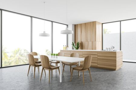 Corner of panoramic kitchen with white walls, concrete floor, wooden countertop with built in sink and cooker, dining table with chairs and cupboard. 3d rendering Reklamní fotografie