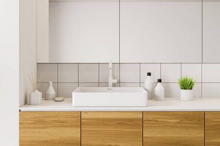 Close up of bathroom sink standing on wooden countertop in modern room with white tile walls and large mirrors. 3d rendering Reklamní fotografie
