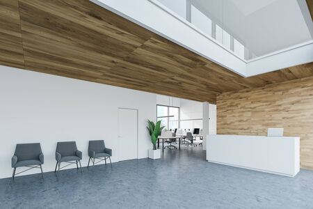 Corner of modern office with white and wooden walls, concrete floor, white reception desk with laptop on it and gray armchairs. 3d rendering Reklamní fotografie