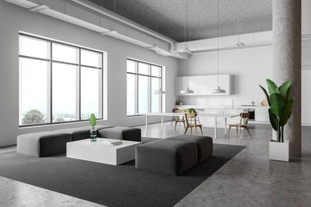 Corner of modern kitchen and living room with white walls, concrete floor, white countertops, bar with stools, dining table and gray sofas near coffee table. 3d rendering Banco de Imagens