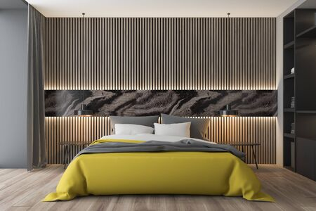 Interior of stylish bedroom with white, gray and wooden walls, wooden floor, king size bed with yellow blanket, two bedside tables and wardrobe. 3d rendering 写真素材