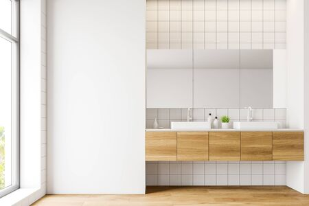 Interior of comfortable bathroom with white tile walls, wooden floor, double sink standing on wooden countertop and large mirrors above it. 3d rendering