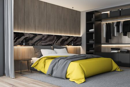Corner of stylish bedroom with white, gray and wooden walls, wooden floor, king size bed with yellow blanket, bedside table and wardrobe. 3d rendering