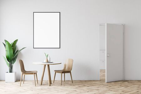 Interior of modern dining room with white walls, wooden floor, round table with wooden chairs, door and vertical mock up poster frame. 3d rendering Stock Photo