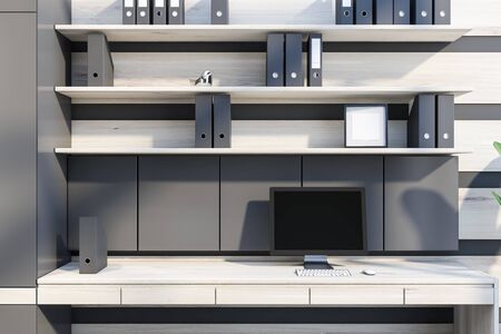 Close up of modern office workplace with gray and wooden walls, wooden computer table with desktop and shelves with folders above it. 3d rendering
