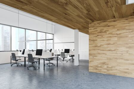 Corner of open space office with white and wooden walls, concrete floor, rows of white computer desks with gray chairs and window with cityscape. 3d rendering