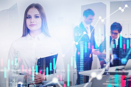 Confident young businesswoman with notebook and two businessmen working in office with double exposure of cityscape and graphs. Concept of trading. Toned image blurred