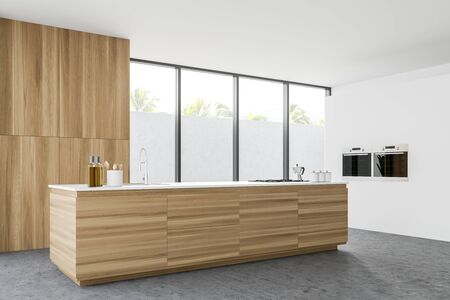 Corner of modern kitchen with white walls, concrete floor, wooden countertop with built in sink and cooker, two ovens and cupboard. 3d rendering