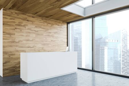 White reception table with laptop on it standing in modern office corner with wooden walls, concrete floor and panoramic window. 3d rendering