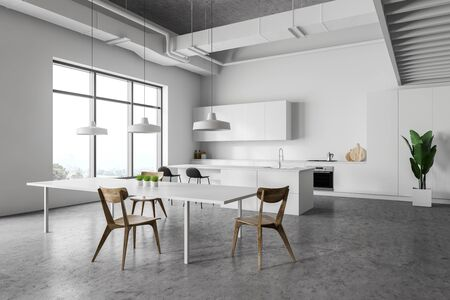 Corner of modern kitchen with white walls, concrete floor, white countertops and cupboards, bar with stools and white dining table with chairs. 3d rendering