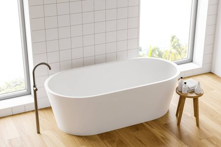 Top view of minimalistic bathroom with white tile walls, wooden floor, comfortable white bathtub and chair with towels and bottles. 3d rendering Фото со стока
