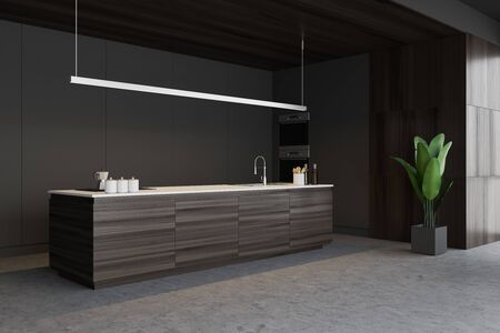 Corner of stylish kitchen with gray and wooden walls, concrete floor, dark wooden island with built in sink and cooker and two ovens. 3d rendering