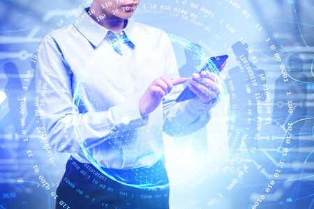 Young businesswoman using smartphone with her colleauges in background and double exposure of planet hologram and network interface. Toned image