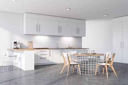 Corner of modern kitchen with white walls, concrete floor, white countertops and cupboards, bar with stools and stylish round dining table with chairs. 3d rendering