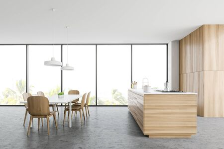 Side view of panoramic kitchen with white walls, concrete floor, wooden countertop with built in sink and cooker, dining table with chairs and cupboard. 3d rendering